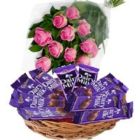 Flowers in India having Dairy Milk Basket 12 Chocolates With 12 Pink Roses to India