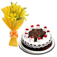 Send Online Cake to India including Yellow Lily 1/2 Kg Black Forest Cake to India