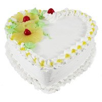 Heart Shaped Cakes to India having 1 Kg Eggless Heart Shape Pineapple Cake in India