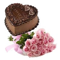 Midnight Cake Delivery in India having Bunch of 15 Pink Roses 1 Kg Heart Shape Chocolate Truffle Cake to India