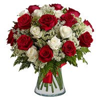 Send Flowers to India comprising Red White Roses Vase 36 Flowers in India
